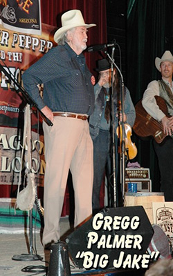 Gregg Palmer of Big Jake on stage with The Sunset Pioneers at the Western Film Festival in Tombstone